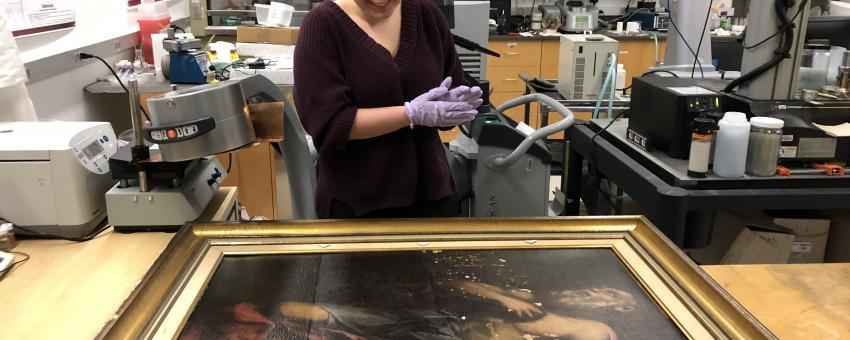 "Caroline Longo, students in Suzanne Deal Booth Seminar ""The Material Science of Art,"" prepares to use x-radiography to examine The Penitent St. Jerome at the Smart Museum of Art."