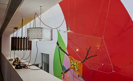 Prof. Jessica Stockholder, Rose's Inclination, 2015. Paint, carpet, fragment of Judy Ledgerwood's painting, branches, rope, Plexiglas, light fixtures, hardware, extension cord, mulch, Smart Museum foyer, courtyard and sidewalks. Commissioned by the The University of Chicago's Smart Museum of Art. Courtesy of the artist, Mitchell-Innes & Nash Gallery, and Kavi Gupta Gallery