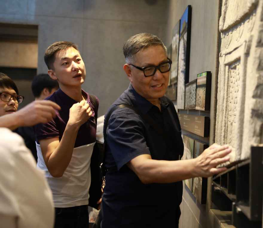 """Wu Hung shows students details of a sculptural relief. Published in 2020, his award-winning book """"First Class"""" uses 24 of his opening class lectures to illustrate how he structures the study of Chinese art history."""