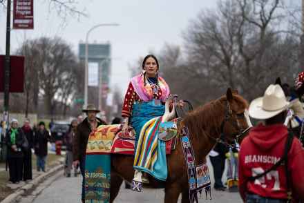 Curator Nina Sanders, a visiting fellow at the Neubauer Collegium, sits on horseback at a parade to open Apsáalooke Women and Warriors on March 12, 2020. The exhibition grew out of the Open Fields research project, one of 111 faculty-led collaborations the Neubauer Collegium has supported since its 2012 launch. Photo by Max Herman.
