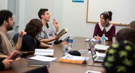 Lecturer Rachel DeWoskin (right) leads students in a fiction writing course at Taft House.